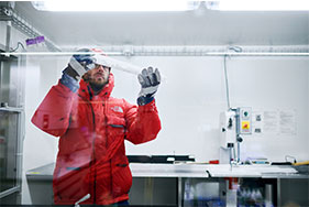 Researcher at work in an ice lab